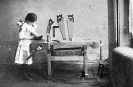 girl at carpenter bench